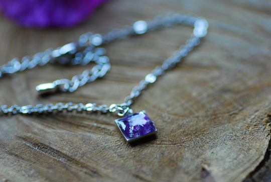 tiny elegant bracelet with resin cast febuary birthstone amethyst stones