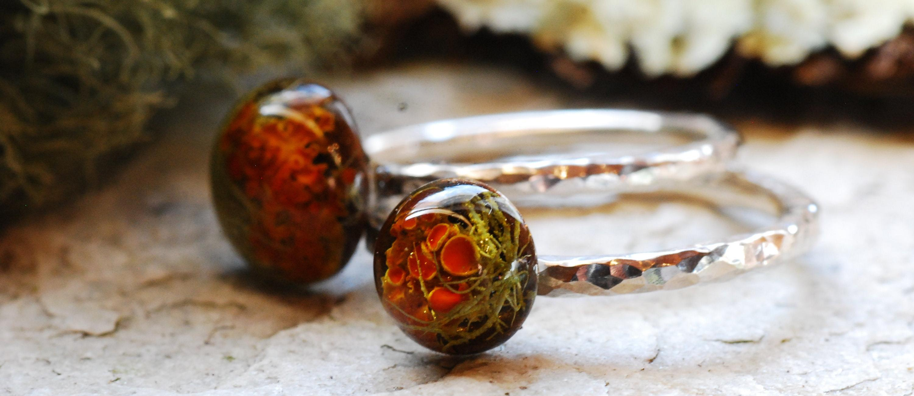 banner hammered sterling silver ring with rich orange lichen and moss cabochon