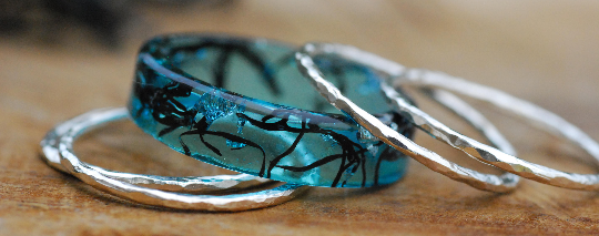 banner showing blue oceanic black algae band with thin stacking silver tings
